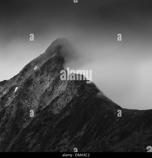 Clouds on a mountain massif, Jotunheimen National Park, Norway - Stock Image