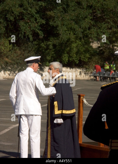 The Hon Judge John Alcantara CBE, the Mayor of Gibraltar, talking with a senior Naval Officer dignitary dignitaries - Stock Image