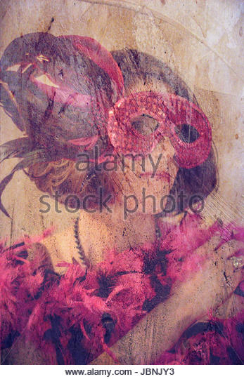 Brunette woman in costume and mask - Stock Image
