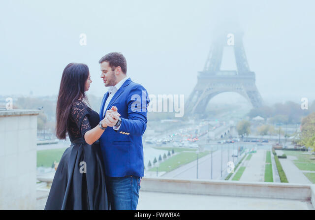 romantic moment near Eiffel tower, portrait of couple in love - Stock-Bilder