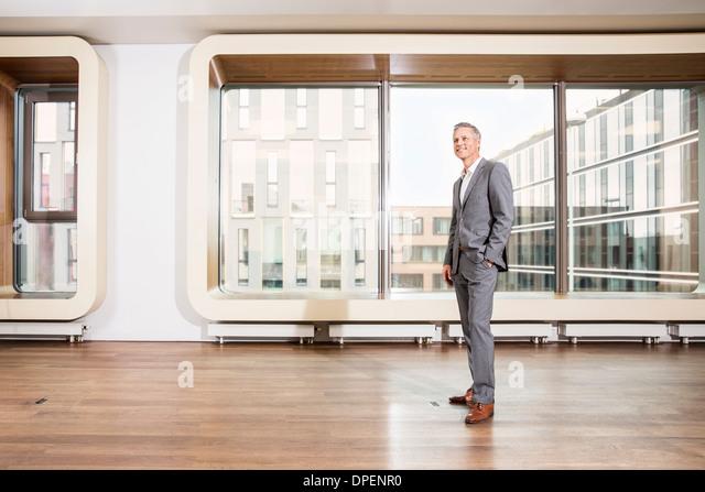 Businessman standing in office - Stock-Bilder