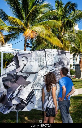 Miami Beach Florida Collins Park art installation Art Basel Public sculpture man woman couple looking - Stock Image