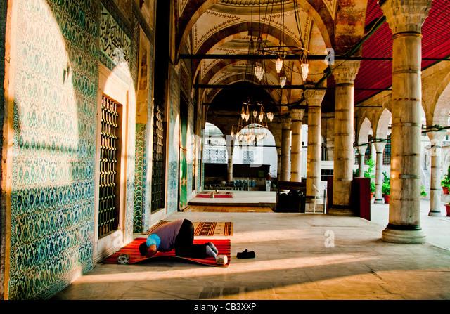 Man praying in Rustem Pasha Mosque. Istanbul, Turkey. - Stock Image