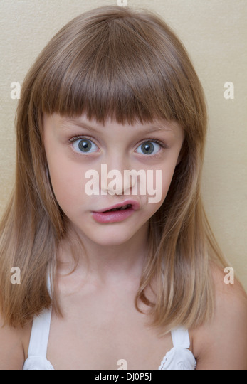 Little girl make a grimace - Stock Image
