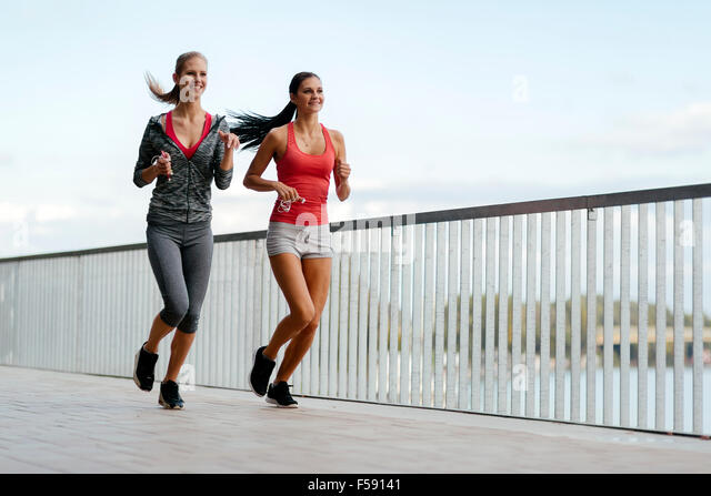 Fit women jogging outdoors and living a healthy lifestyle - Stock-Bilder