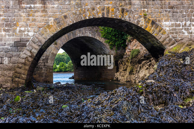 Two stone arches over a river near Audierene, Brittany, France - Stock Image