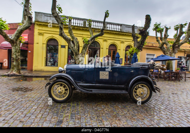 Old car used as taxi on cobblestone street in Colonia del Sacramento, Uruguay, South America - Stock Image