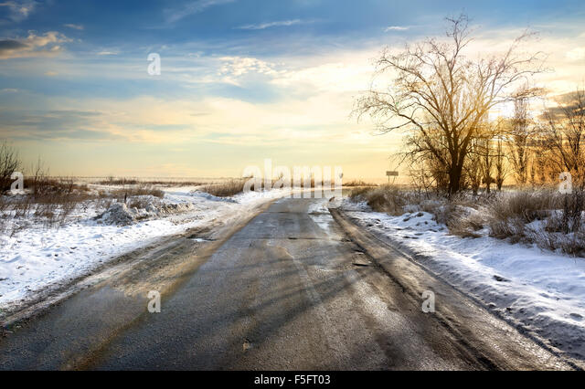 Road in winter at the beautiful sunset - Stock Image