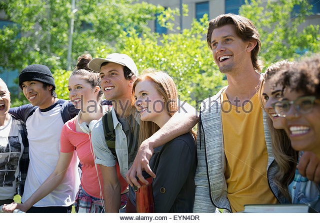 Smiling college students in a row - Stock Image