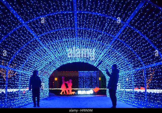 Shenyang, Shenyang, China. 29th Dec, 2016. The lighting show of 9,999 white rose shaped lights illuminates the street - Stock Image