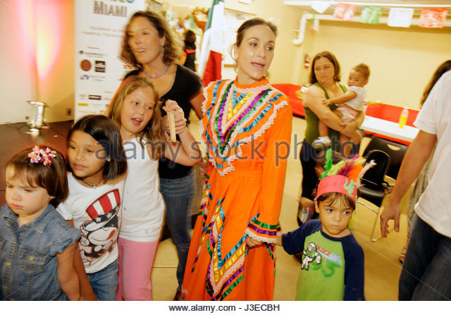 Miami Florida Miami Art Central Festival Mexico Miami Jalisco dress outfit Hispanic woman women girls boys child - Stock Image