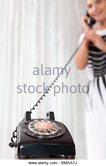 Young woman using vintage telephone - Stock-Bilder