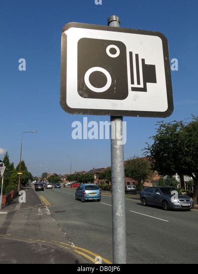 British speed camera sign in front of a summer blue sky, on the A50 main road - Stock Image