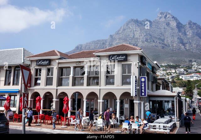 Cape Town South Africa African Camps Bay Victoria Road Kauai restaurant alfresco dining Table Mountain National - Stock Image