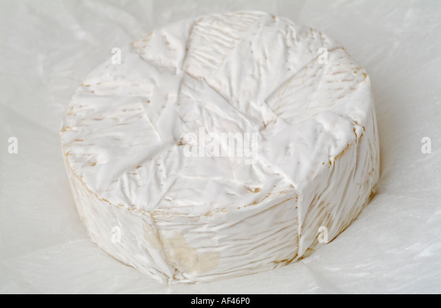 Camembert Cheese on its White Grease Proof Paper - Stock Image