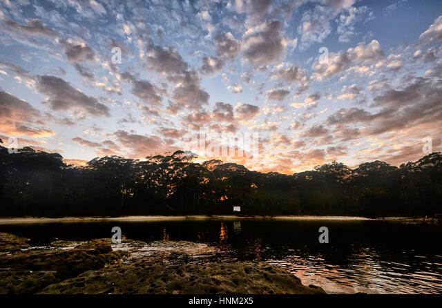 Dramatic sunrise over Honeymoon Bay, Jervis Bay, South Coast, New South Wales, NSW, Australia - Stock Image