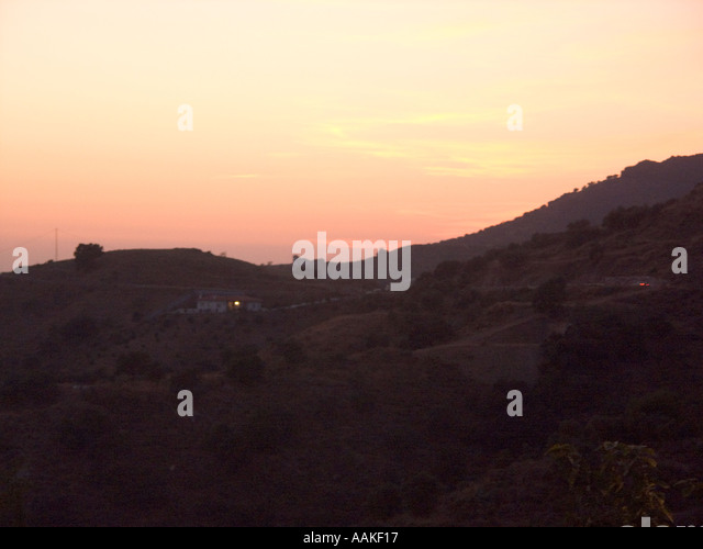 Sunset over the Sierra de Tejeda mountains in the Axarquía region of Southern Spain Europe Spanish sunsets - Stock Image