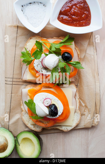 Sandwich with peppers, eggs, avocado - Stock Image
