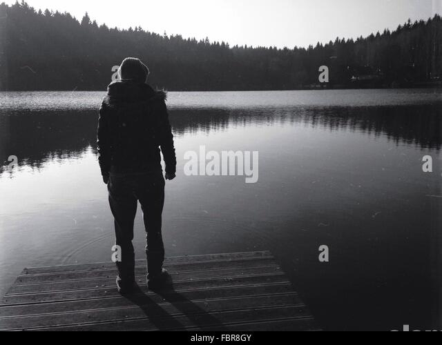 Man Standing On Jetty - Stock Image