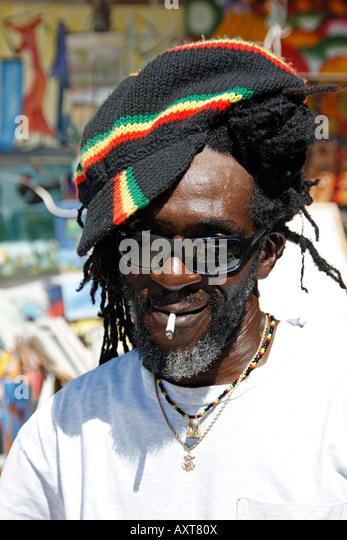 Jamaica Negril beach Rastafarian man - Stock Image
