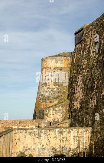 Castillo San Felipe del Morro fortress young girl dwarfed by size of the huge fort, Old San Juan, Puerto Rico - Stock Image