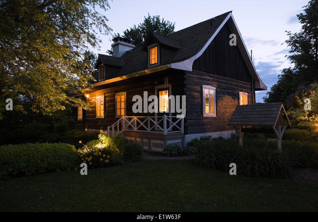 Log cabin exterior light stock photos log cabin exterior for Old style log homes
