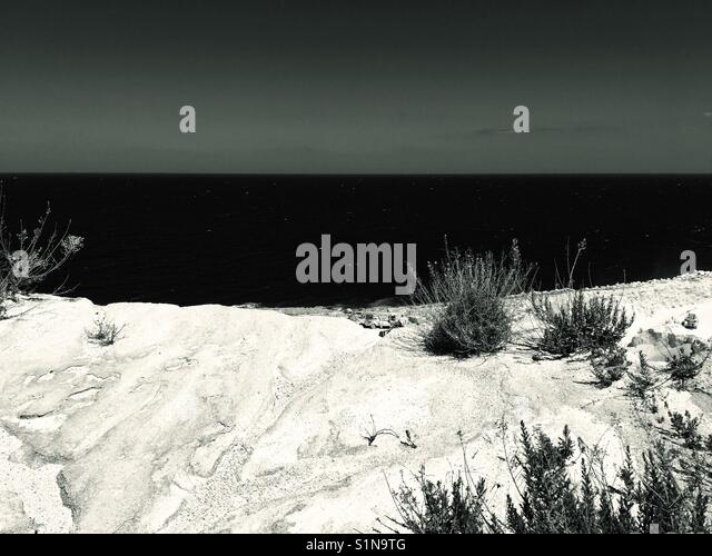 Black and white abstract view of coast and sea ocean - Stock Image