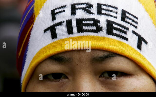 A member of German NGO 'David gegen Goliath e.V.' protest on the Chinese actions against Tibet at the Marien - Stock Image