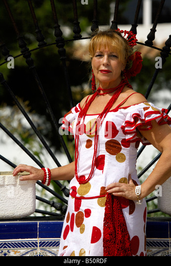 Beautiful blond middle aged Spanish woman in traditional costume, Andalucia, Spain, Europe, - Stock Image