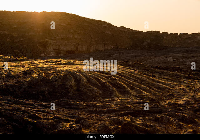 Evening light catches the golden Pele's hair at the summit of Erta Ale - Stock Image