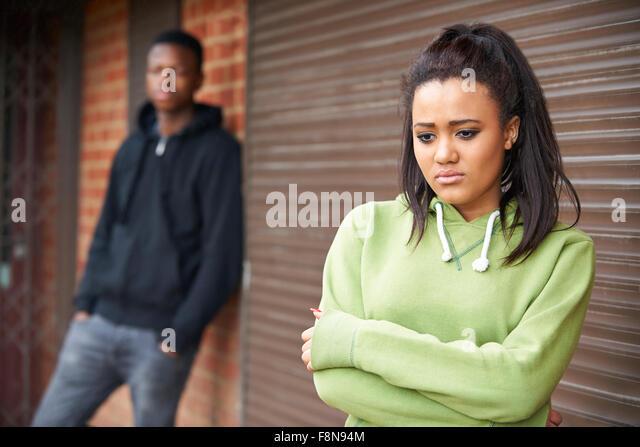 Portrait Of Unhappy Teenage Couple In Urban Setting - Stock-Bilder