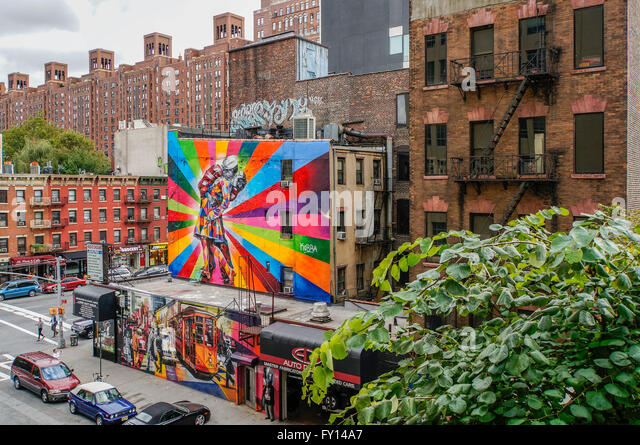 Graffiti art installation on buildings seen from the High Line, Meatpacking district, New York City - Stock Image