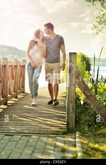 Couple walking on the bridge - Stock Image