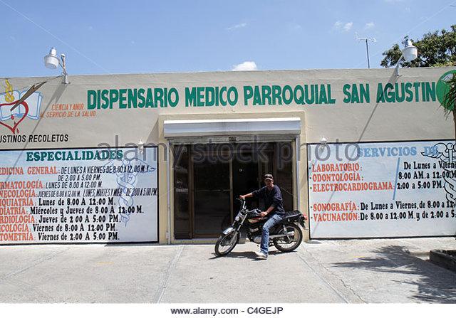 Santo Domingo Dominican Republic Bajos de Haina medical clinic health care facility polyclinic facade signage specialty - Stock Image