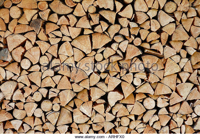 firewood stack close-up (wood log pile) - Stock Image