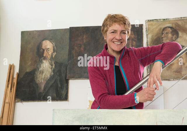 Portrait of a female artist smiling in her studio, Bavaria, Germany - Stock Image
