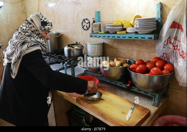 Abu Yousef  preparing delicious Hummus in his small restaurant in Madeba, Jordan. - Stock Image