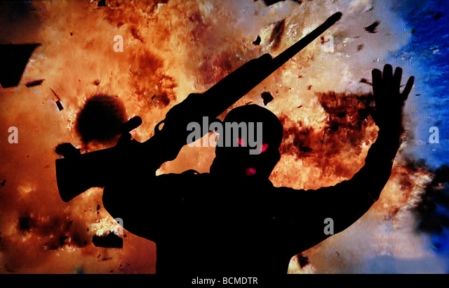 silhouette of masked man with gun running from huge explosion - Stock Image