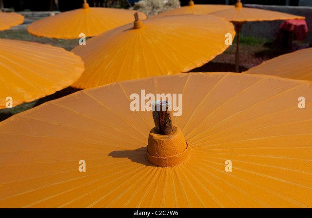 Colorful umbrella under the sun light for dry in Bo Sang Umbrella make factory. Sankamphaeng, Chiang Mai, Thailand - Stock Image