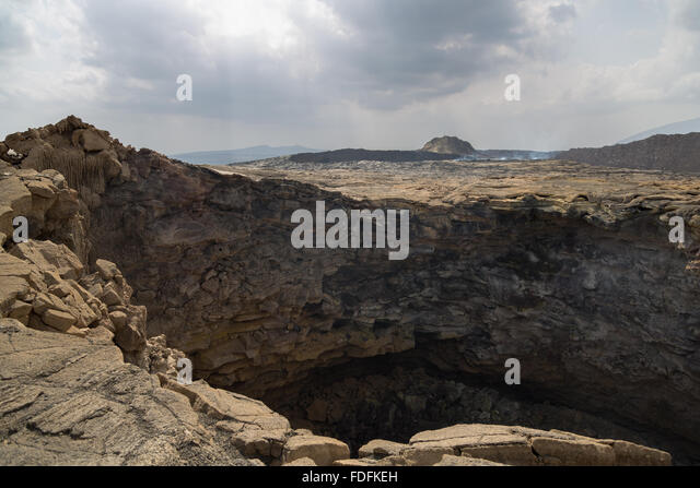 An old crater lies still on Erta Ale - Stock Image