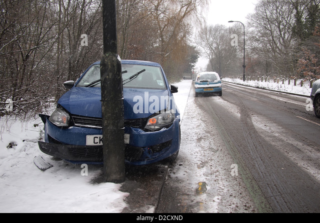 car crash accident in winter snow London UK england - Stock Image