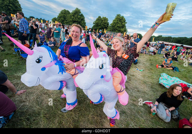 Henham Park, Suffolk, UK 16th July, 2016 Inflatable unicorn costunmes for a birthday girl and her friend - The 2016 - Stock Image
