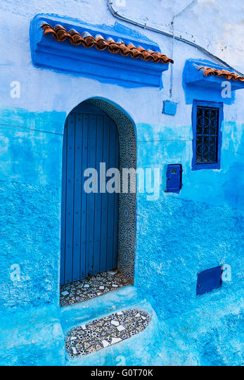 Detail of a door and window in the town of Chefchaouen, in Morocco - Stock-Bilder