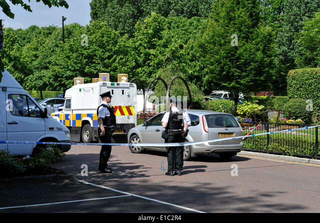 Derry, Londonderry, Northern Ireland. 30th May, 2014. Forensic Officers at the scene of a firebomb attack in the - Stock Image