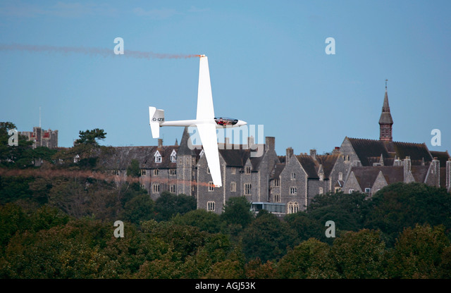 Guy Westgate piloting S-1 Swift glider over Lancing College at Shoreham Airshow - Stock Image