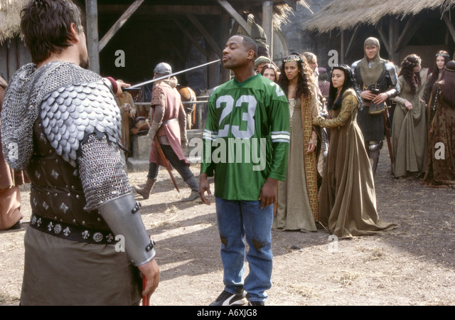 BLACK KNIGHT 2001 20th Century Fox film with Vincent Regan as the evil Knight Percival at left and Martin Lawrence - Stock Image