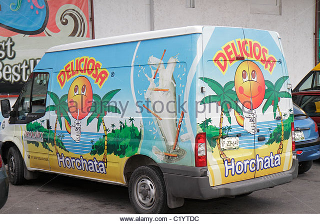 Cancun Mexico Yucatán Peninsula Quintana Roo Avenida Coba delivery van commercial vehicle painted advertising - Stock Image
