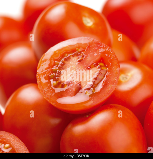 Cherry Tomatoes with one sliced - Stock Image