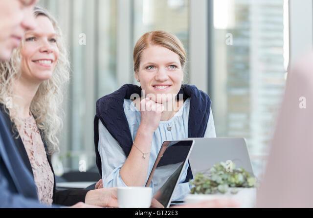 Happy businesswomen sitting in meeting at office - Stock-Bilder