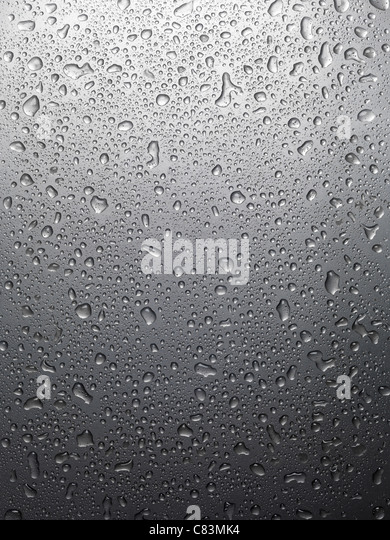 Wet shiny gray metal with drops of water background texture - Stock-Bilder